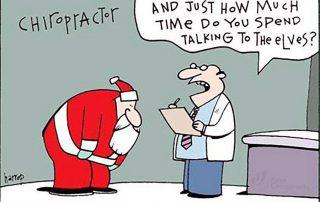Santa hunched over talking to elves